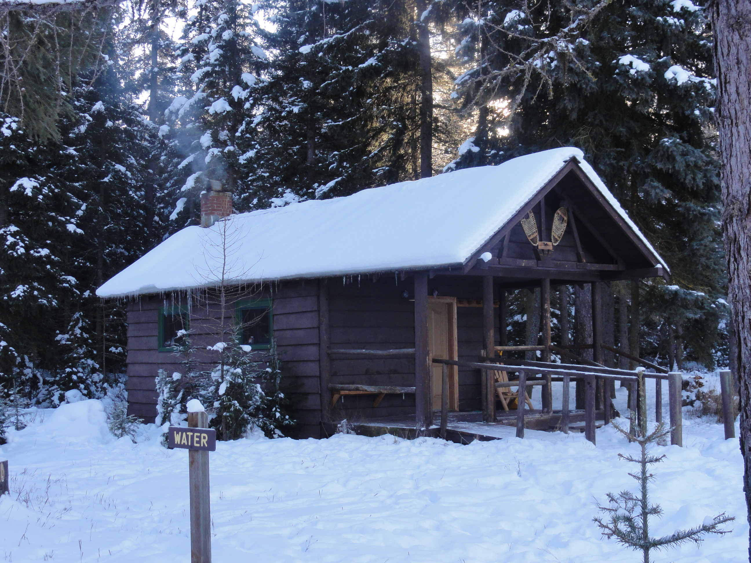 Log cabin in the woods winter - Feeling Like You Want To Rough It But Just A Little Not Up To Hauling Everything On Your Back And Skiing Miles To Get To A Cold Cabin In The Woods